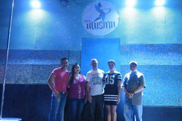Team Acadeo poses with Club Illusion's owners.