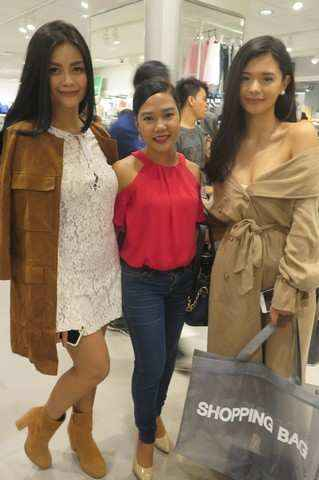 Acadeo member Yani (middle) poses with fashion bloggers; Vern and Verniece Enciso